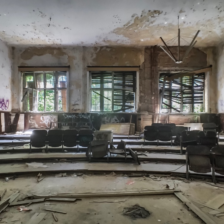 Abandoned auditorium in one of the buildings at Belitz-Heilstätten