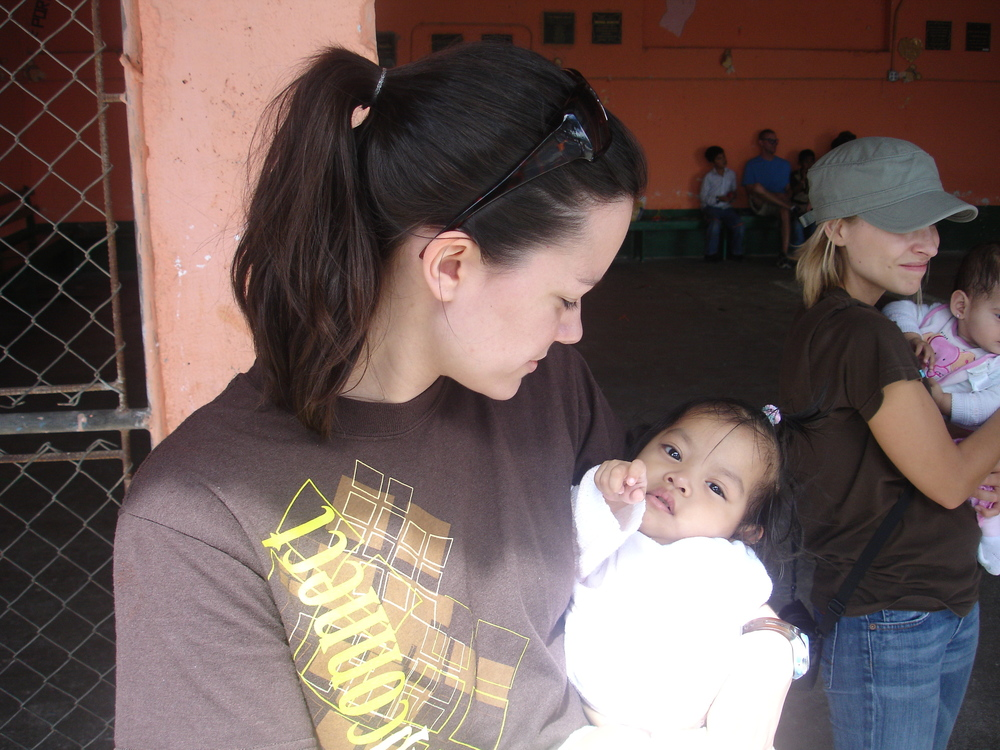 Angela meeting Selena at the orphanage that first week.