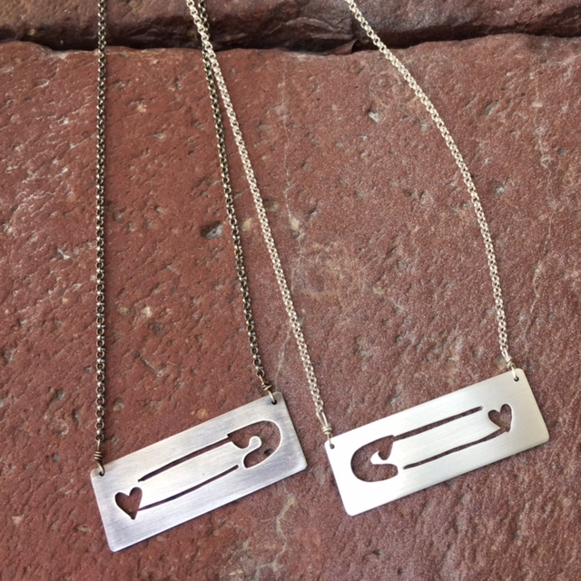 Safety Pin necklaces are raising bucks for the ASLU and keeping me busy in this post-election haze.  I feel like I'm mourning the country I thought I lived in and appreciate this movement as a way to wear my bleeding heart on my sleeve.    e  tsy listing here