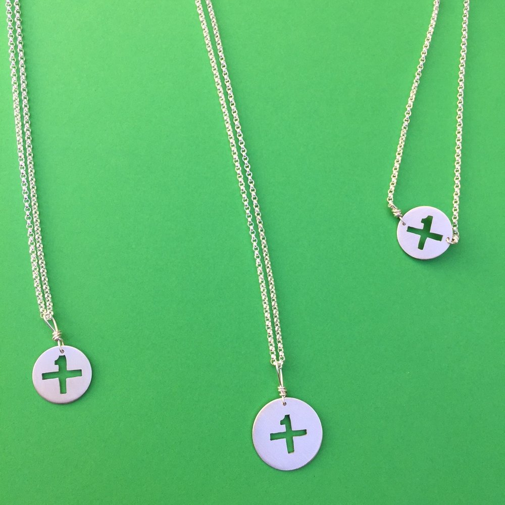 Down's Syndrome Awareness Symbol designed by the DSG in Kansas City-- $5 from each purchase is donated back to DSG KC.    etsy listing here