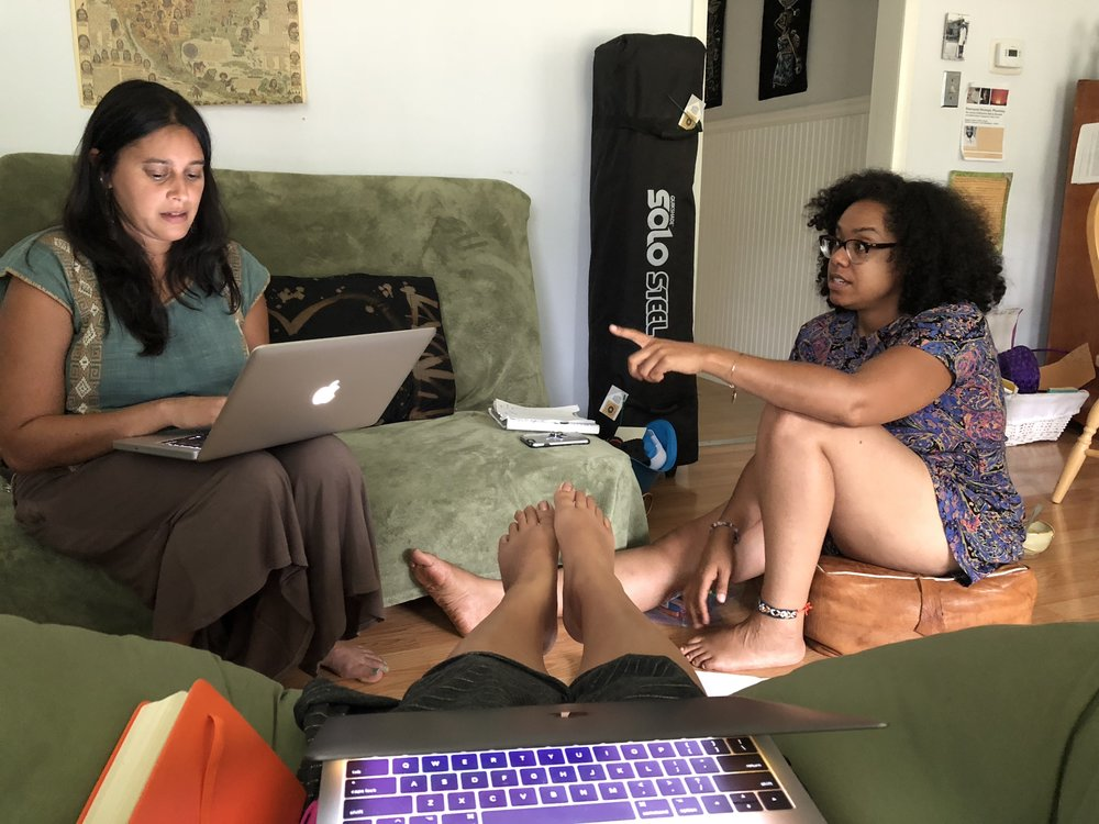 YES! Executive Director Shilpa Jain, Cowry Collective Founder Chinyere Esther & the toes of POLLEN Institute Founder Maya Corinne in our St. Louis livingroom