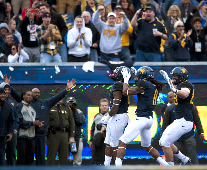 West Virginia's Dreamius Smith celebrates a touchdown against Baylor during an NCAA football game on Saturday, Oct. 18, 2014 at Milan Puskar Stadium in Morgantown, W.Va. WVU won 41-27.