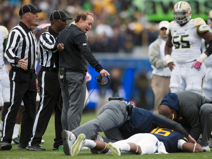 West Virginia head coach Dana Holgorsen reacts to officials after an injury to Terrell Chestnut during an NCAA football game against Baylor on Saturday, Oct. 18, 2014 at Milan Puskar Stadium in Morgantown, W.Va. WVU won 41-27.