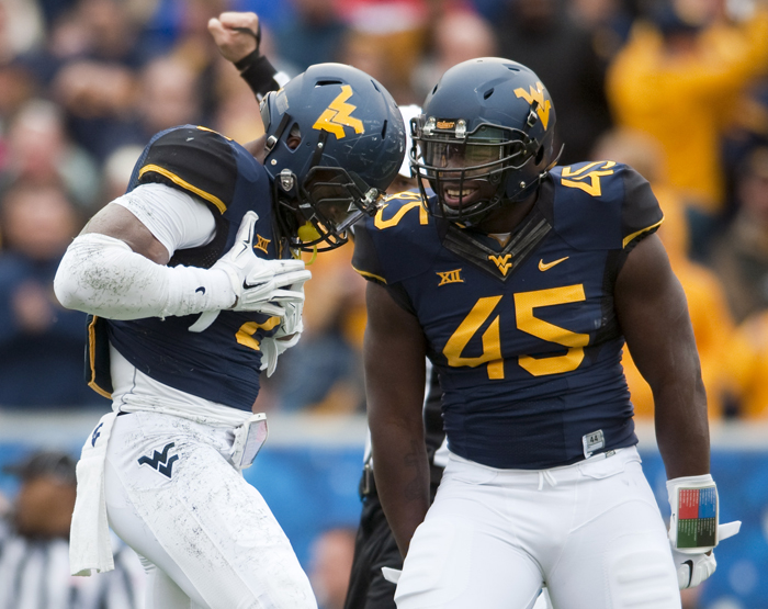West Virginia's Brandon Golson celebrates his sack with Eric Kinsey during an NCAA football game against Baylor on Saturday, Oct. 18, 2014 at Milan Puskar Stadium in Morgantown, W.Va. WVU won 41-27.