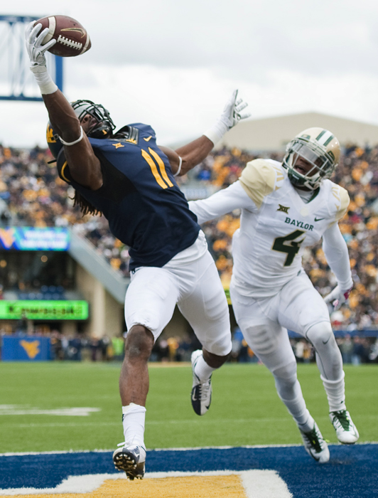 West Virginia's Kevin White catches a touchdown pass with one hand over Baylor's Xavien Howard during an NCAA football game on Saturday, Oct. 18, 2014 at Milan Puskar Stadium in Morgantown, W.Va. WVU won 41-27.