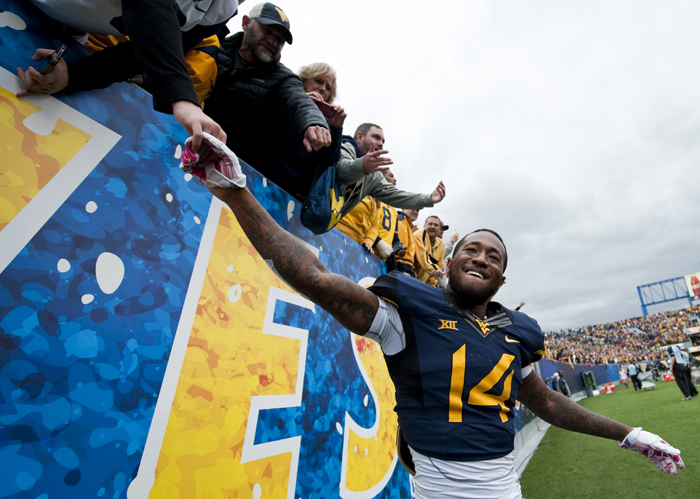 West Virginia's Ricky Rumph celebrates with fans after the win over Baylor an NCAA football game on Saturday, Oct. 18, 2014 at Milan Puskar Stadium in Morgantown, W.Va. WVU won 41-27.