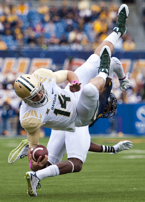 Baylor quarterback Bryce Petty is upended by West Virginia's Daryl Worley during an NCAA football game on Saturday, Oct. 18, 2014 at Milan Puskar Stadium in Morgantown, W.Va. WVU won 41-27.