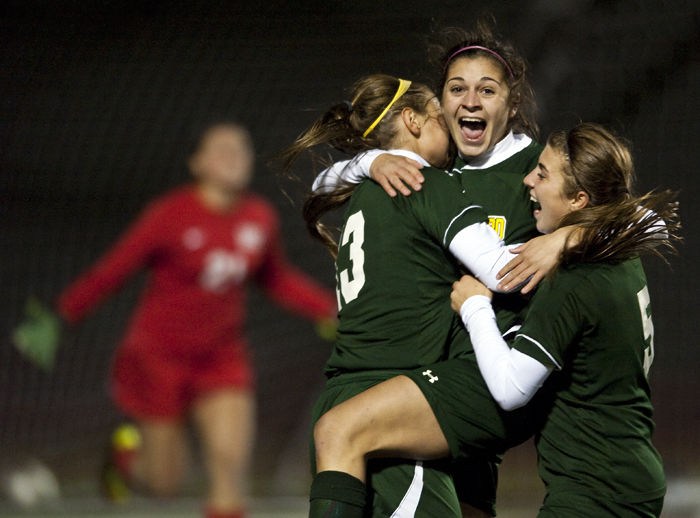 Penn-Trafford's Maggie Mastrogiacomo, center, celebrates the game-winning goal in overtime with teammates Casey Aunkst (13) and Italia Biondi on Wednesday, Oct. 22, 2014 at Elizabeth Forward High School. Penn-Trafford beat Upper St. Clair 2-1.