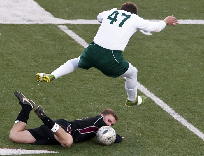 Greensburg Central Catholic's Adam Tucker looks toward the ball as Geibel's Brent Plisko leaps over him on Thursday, Oct. 23, 2014 at Elizabeth Forward High School. Geibel won 2-1.