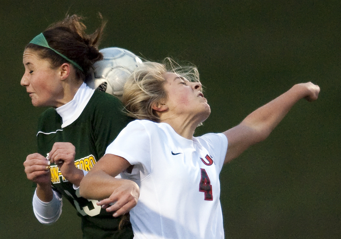 Penn-Trafford's Casey Aunkst and Upper St. Clair's Kelsey McKown fight for the ball on Wednesday, Oct. 22, 2014 at Elizabeth Forward High School. Penn-Trafford beat Upper St. Clair 2-1.