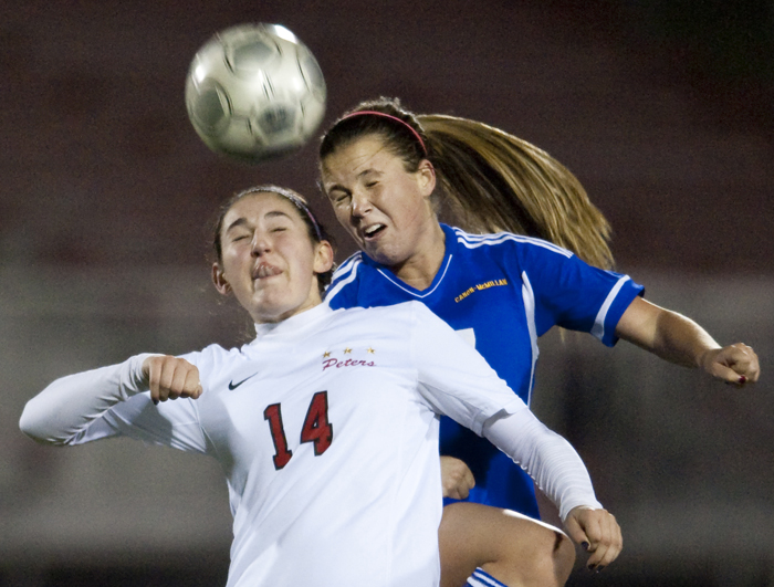 Peters Township's Madison Schwerzler and Canon-McMillan's Allie Thomas fight for the ball on Wednesday, Oct. 22, 2014 at Elizabeth Forward High School. Canon-McMillan won 2-1 in a shootout.