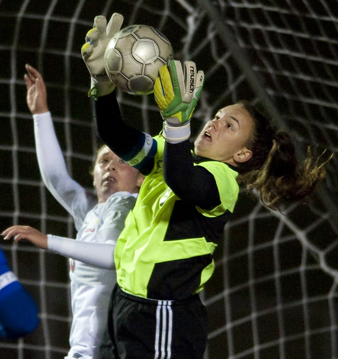 Canon-McMillan goalkeeper Kyra Murphy makes one of her many saves against Peters Township on Wednesday, Oct. 22, 2014 at Elizabeth Forward High School. Canon-McMillan won 2-1 in a shootout.