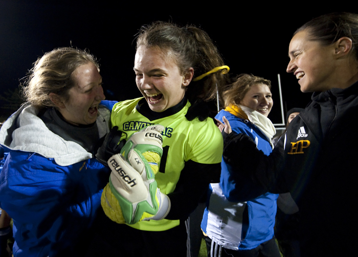 Canon-McMillan goalkeeper Kyra Murphy is bombarded by her teammates after she made the last save against Peters Township during a shootout on Wednesday, Oct. 22, 2014 at Elizabeth Forward High School. Canon-McMillan won 2-1 in a shootout.