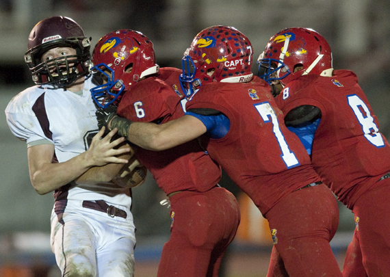 Jeannette's Gio Vonne Sanders (6), Zack Altieri (7) and Mark Wormack bring down Greensburg Central Catholic's Steven Johns on Friday, Oct. 24, 2014 at McKee Stadium in Jeannette. Jeannette won 36-0.