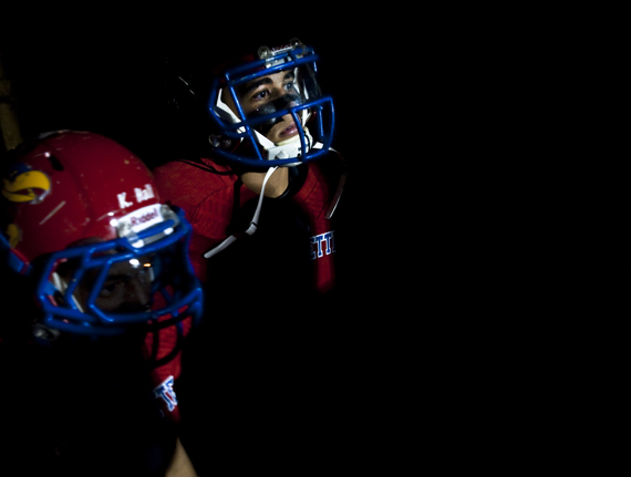 Jeannette's Julian Batts prepares to take the field inside the locker room before playing Greensburg Central Catholic on Friday, Oct. 24, 2014 at McKee Stadium in Jeannette. Jeannette won 36-0.