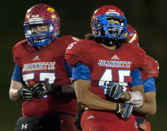 Jeannette's Jefferson Jones celebrates a sack against Greensburg Central Catholic on Friday, Oct. 24, 2014 at McKee Stadium in Jeannette. Jeannette won 36-0.
