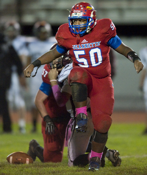 Jeannette's Tremayne Briston celebrates a sack against Greensburg Central Catholic on Friday, Oct. 24, 2014 at McKee Stadium in Jeannette. Jeannette won 36-0.