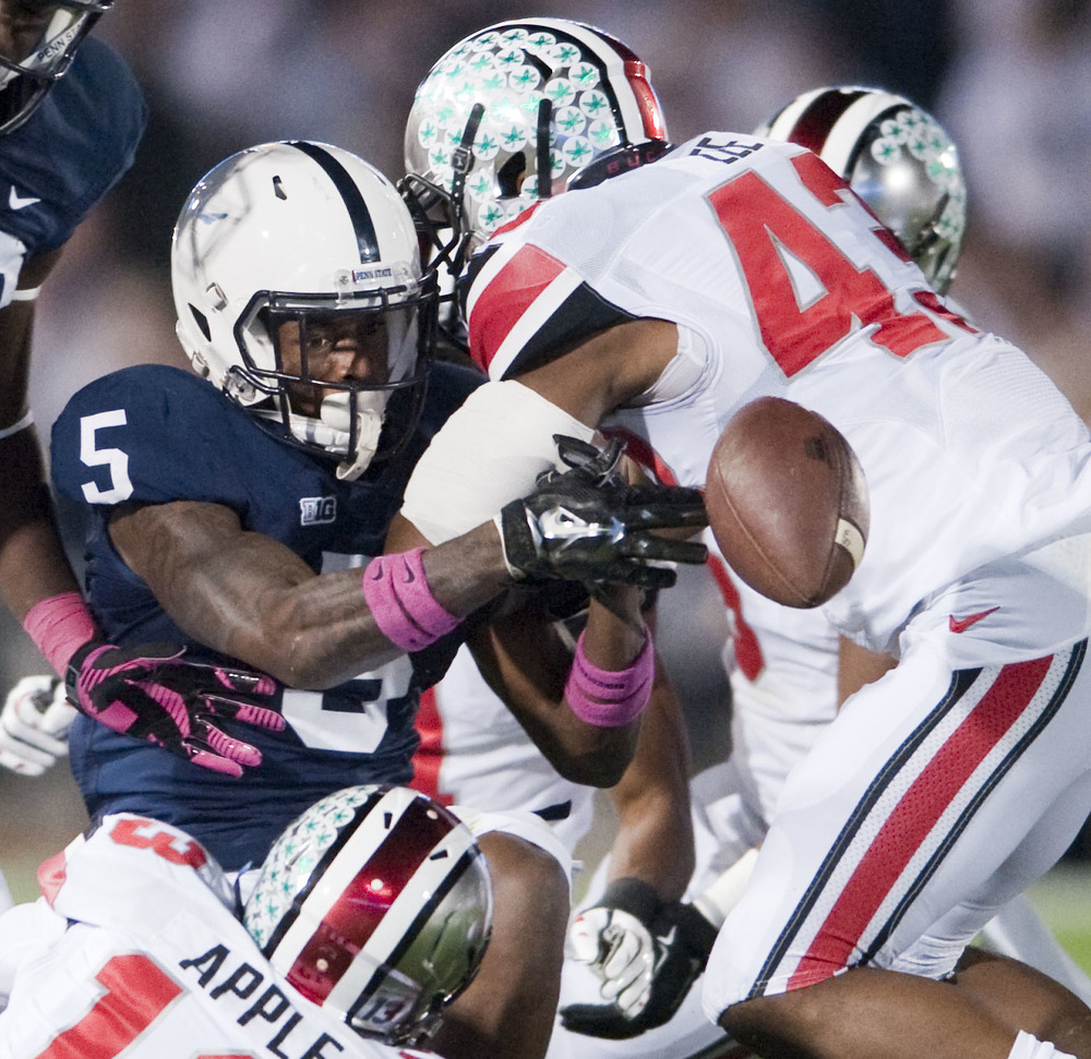 Penn State wide receiver DaeSean Hamilton (5) fumbles the ball against Ohio State during the second quarter at Beaver Stadium on Oct. 25, 2014, in University Park. Ohio State won 31-24 in the second overtime.