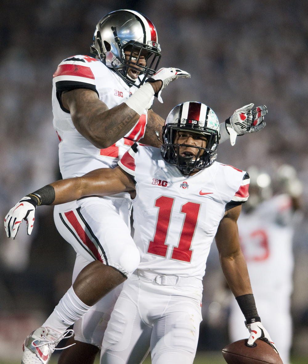 Ohio State defensive back Vonn Bell (11) celebrates an interception with Ohio State linebacker Curtis Grant (14) against Penn State during the first quarter at Beaver Stadium on Oct. 25, 2014, in University Park.