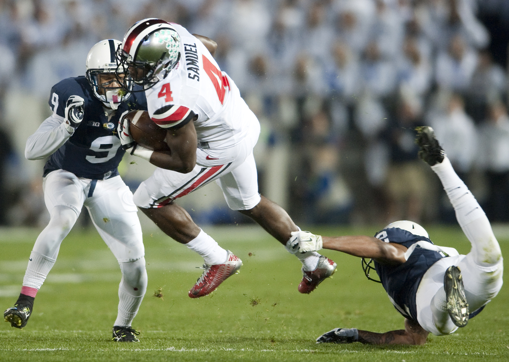 Ohio State running back Curtis Samuel (4) rushes over Penn State safety Marcus Allen (2) at Beaver Stadium on Oct. 25, 2014, in University Park. Ohio State won 31-24 in the second overtime.