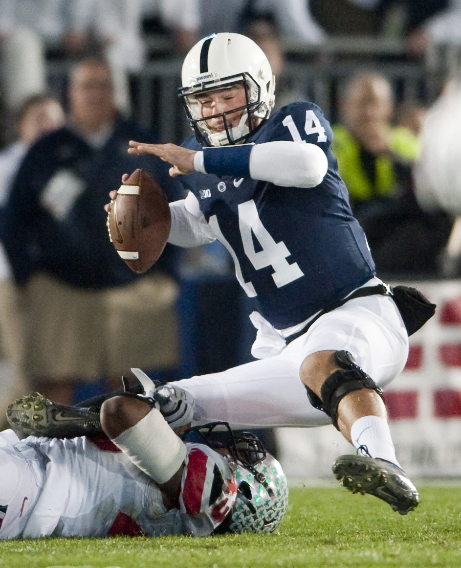 Penn State quarterback Christian Hackenberg (14) is sacked by Ohio State linebacker Darron Lee (43)at Beaver Stadium on Oct. 25, 2014, in University Park.