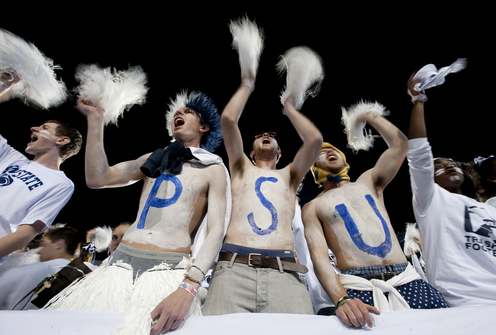 Penn State fans shake white pom poms in a sell-out game of 107,895 against Ohio State at Beaver Stadium on Oct. 25, 2014, in University Park. Ohio State won 31-24 in the second overtime.