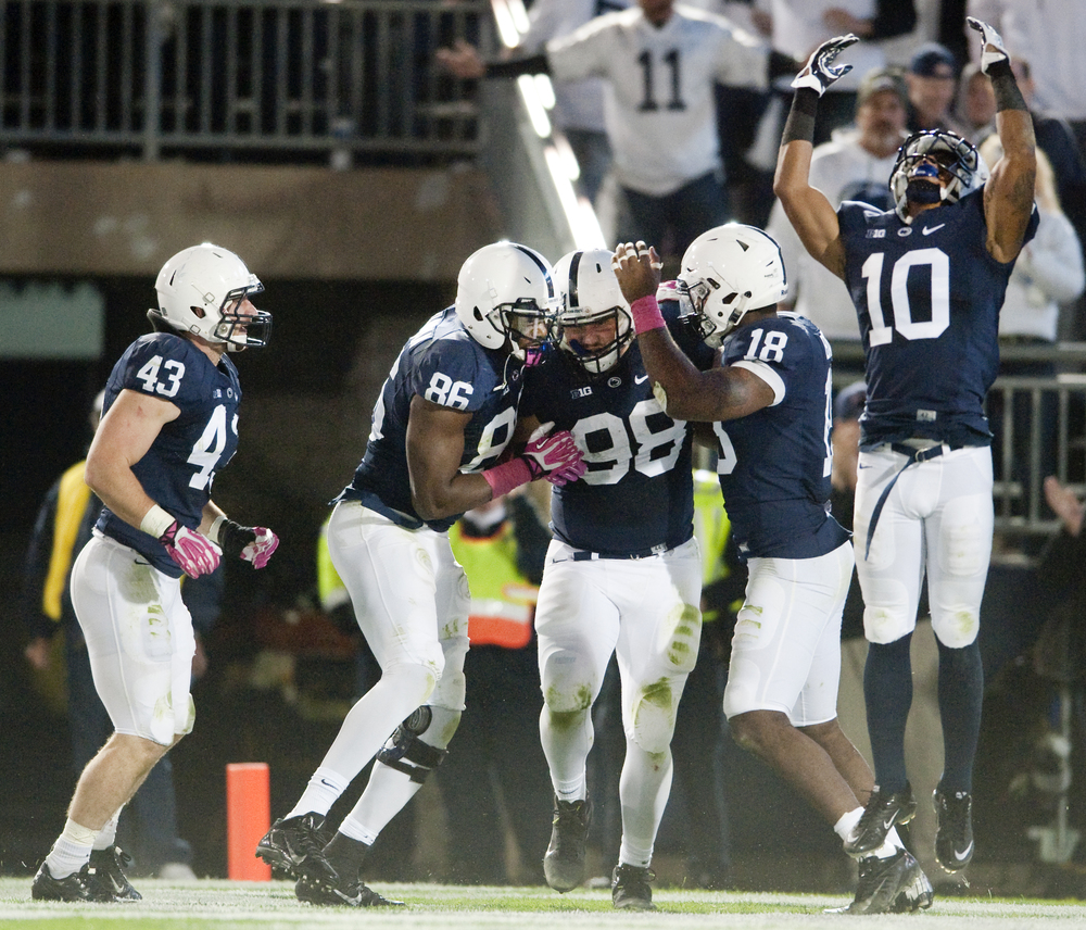 Penn State defensive tackle Anthony Zettel (98) celebrates his interception for a touchdown with teammates Ohio State at Beaver Stadium on Oct. 25, 2014, in University Park.