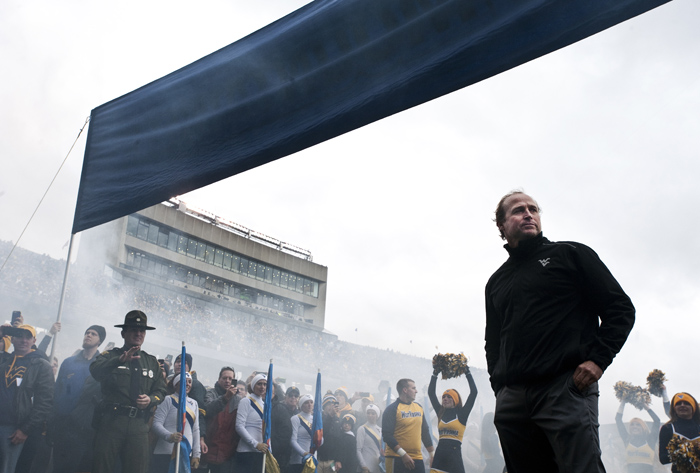 West Virginia head coach Dana Holgorsen waits to lead his team onto the field before playing TCU on Saturday, Nov. 1, 2014 in Morgantown, W.Va. TCU beat West Virginia 31-30.