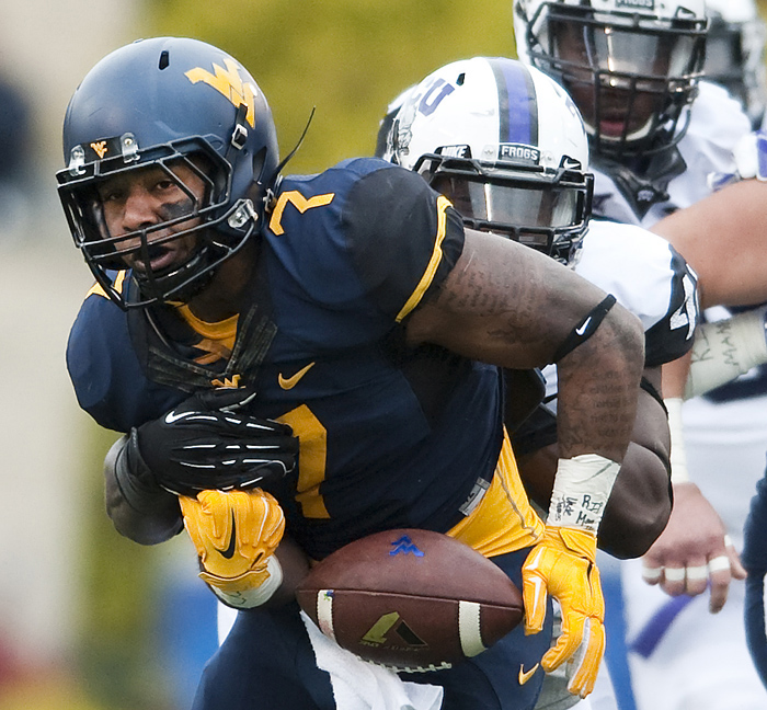 West Virginia running back Rushel Shell (7) is stripped of the ball by TCU defensive end James McFarland (40) on Saturday, Nov. 1, 2014 in Morgantown, W.Va. TCU beat West Virginia 31-30.