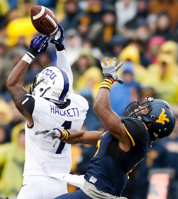 TCU safety Chris Hackett (1) blocks a pass intended for West Virginia wide receiver Daikiel Shorts (6) on Saturday, Nov. 1, 2014 in Morgantown, W.Va. TCU won 31-30.
