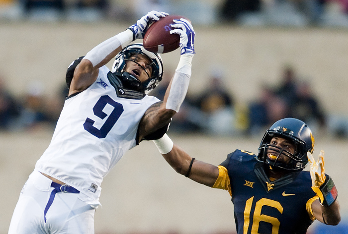 TCU wide receiver Josh Doctson (9) receives a pass against West Virginia cornerback Terrell Chestnut (16) on Saturday, Nov. 1, 2014 in Morgantown, W.Va. TCU won 31-30.