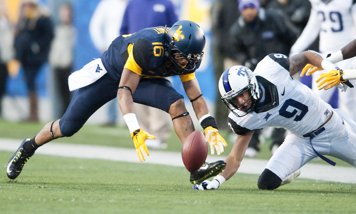 West Virginia cornerback Terrell Chestnut (16) recovers a fumble for a touchdown against TCU wide receiver Josh Doctson (9) on Saturday, Nov. 1, 2014 in Morgantown, W.Va. TCU won 31-30.