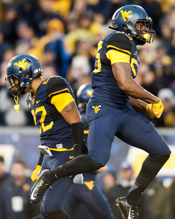 West Virginia linebacker Xavier Preston (53) reacts with West Virginia safety Jarrod Harper (22) after a big hit against TCU on Saturday, Nov. 1, 2014 in Morgantown, W.Va. TCU won 31-30.