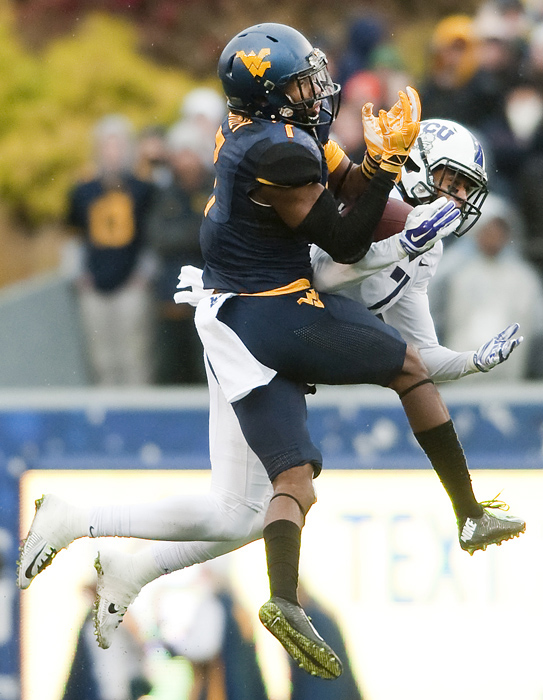 West Virginia cornerback Daryl Worley (7) breaks up a pass intended for TCU wide receiver Kolby Listenbee (7) on Saturday, Nov. 1, 2014 in Morgantown, W.Va. TCU won 31-30.