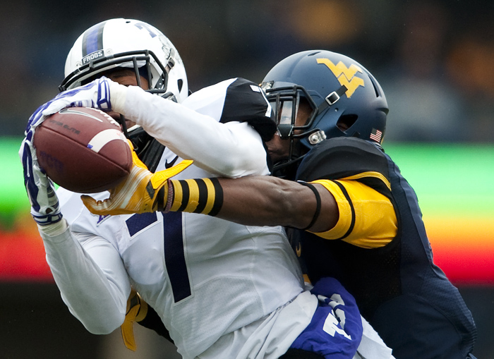 West Virginia cornerback Daryl Worley (7) blocks a pass intended for TCU wide receiver Kolby Listenbee (7) on Saturday, Nov. 1, 2014 in Morgantown, W.Va. TCU won 31-30.