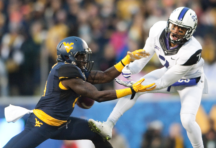 West Virginia safety Karl Joseph (8) nearly intercepts a pass intended for TCU wide receiver Kolby Listenbee (7) on Saturday, Nov. 1, 2014 in Morgantown, W.Va. TCU won 31-30.