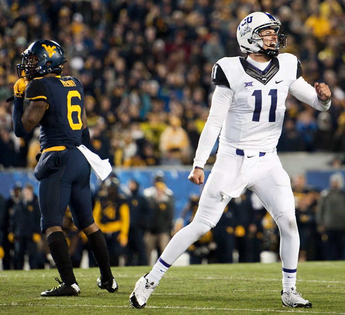 TCU quarterback Zach Allen (11) who held the ball for kicker Jaden Oberkrom celebrates beating West Virginia on Saturday, Nov. 1, 2014 in Morgantown, W.Va. TCU beat West Virginia 31-30.