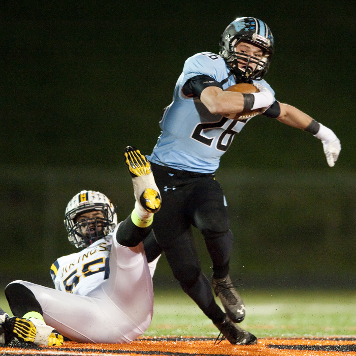 Washington's Jordan West rushes around Apollo-Ridge's Maurice Stankus on Friday, Nov. 7, 2014 at Greater Latrobe High School. Washington won 58-30.