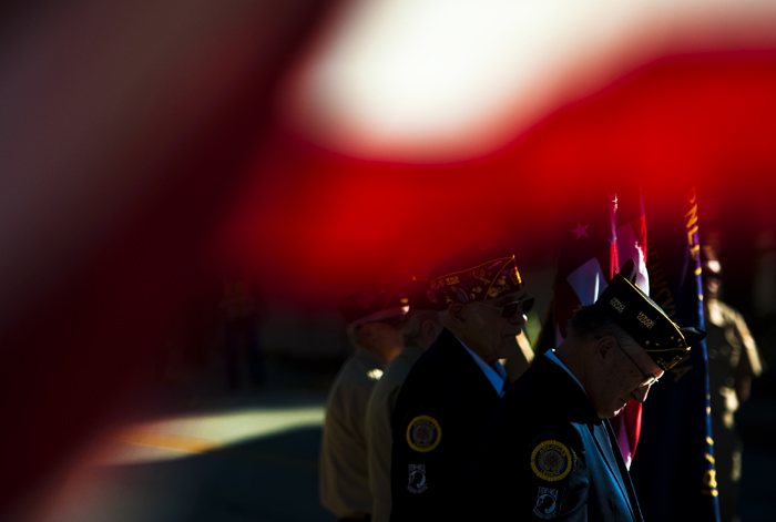 Members of the American Legion post 240 of Scottdale bow their heads during a prayer as a part of a Veterans Day service at the Everson Veterans Memorial at Brown and Jones streets on Tuesday, Nov. 11, 2014.