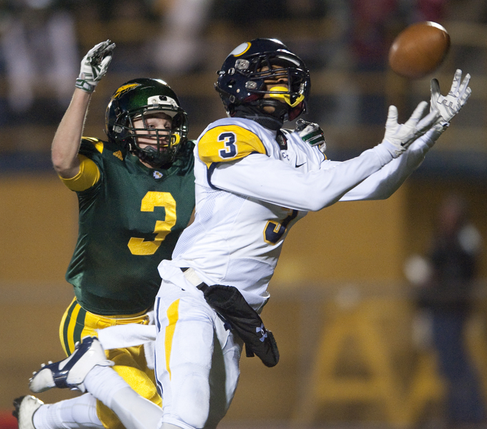 Central Catholic's Damar Hamlin catches a touchdown pass against Penn-Trafford's Timmy Vecchio on Friday, Nov. 14, 2014 at Norwin High School. Central Catholic won 52-34.