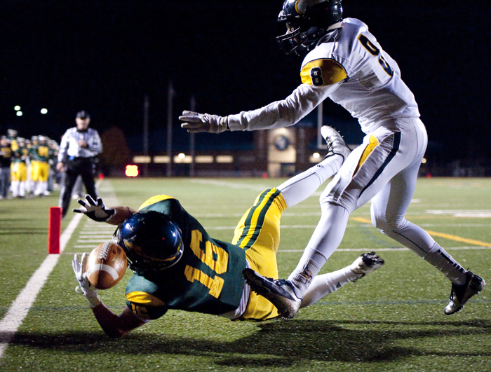 Penn-Trafford's Austin Zegarelli can't pull in a touchdown pass against Central Catholic's Mitchell MacZura on Friday, Nov. 14, 2014 at Norwin High School. Central Catholic won 52-34.