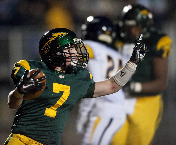 Penn-Trafford's Joe Peduzzi celebrates his touchdown against Central Catholic on Friday, Nov. 14, 2014 at Norwin High School. Central Catholic won 52-34.