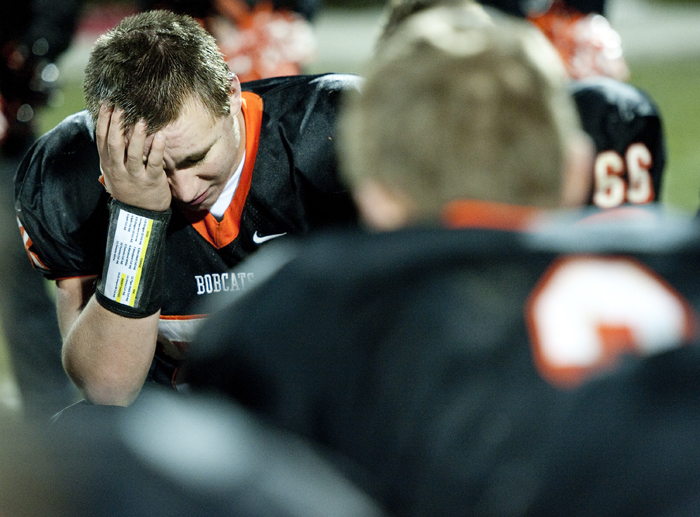 Blairsville's Tom Tripodis reacts to his teams loss against Portage during a District 6 semifinal game on Saturday, Nov. 15, 2014 in Blairsville. Portage won 28-24.