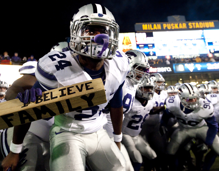 Kansas State prepares to take the field with his teammates before playing West Virginia at Milan Puskar Stadium on Thursday, Nov. 20, 2014 in Morgantown, W.Va. Kansas State won 26-20.