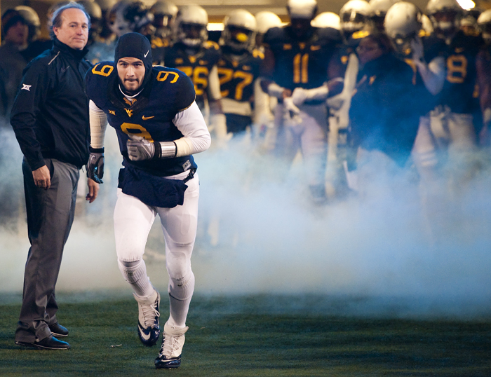 West Virginia quarterback Clint Trickett (9) runs onto the field during senior night against Kansas State at Milan Puskar Stadium on Thursday, Nov. 20, 2014 in Morgantown, W.Va. Kansas State won 26-20.
