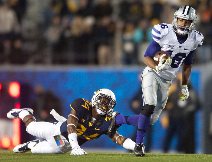 Kansas State wide receiver Tyler Lockett (16) rushes around West Virginia cornerback Ishmael Banks (34) at Milan Puskar Stadium on Thursday, Nov. 20, 2014 in Morgantown, W.Va. Kansas State won 26-20.