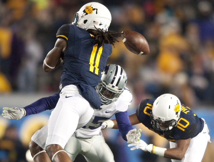 West Virginia wide receiver Kevin White (11) misses a completion while hit by Kansas State defensive back Randall Evans (15) at Milan Puskar Stadium on Thursday, Nov. 20, 2014 in Morgantown, W.Va.