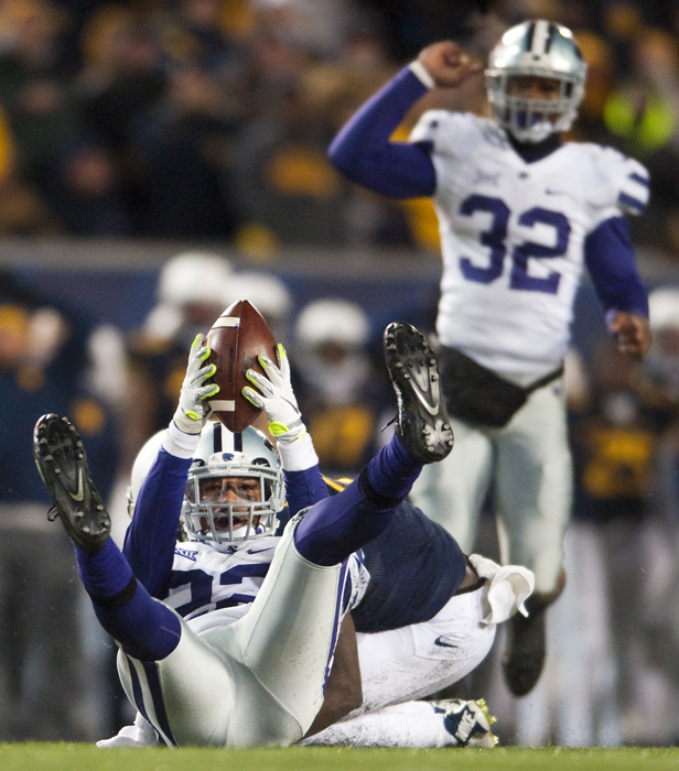 Kansas State defensive back Dante Barnett (22) holds the ball up after an interception against West Virginia at Milan Puskar Stadium on Thursday, Nov. 20, 2014 in Morgantown, W.Va. Kansas State won 26-20.