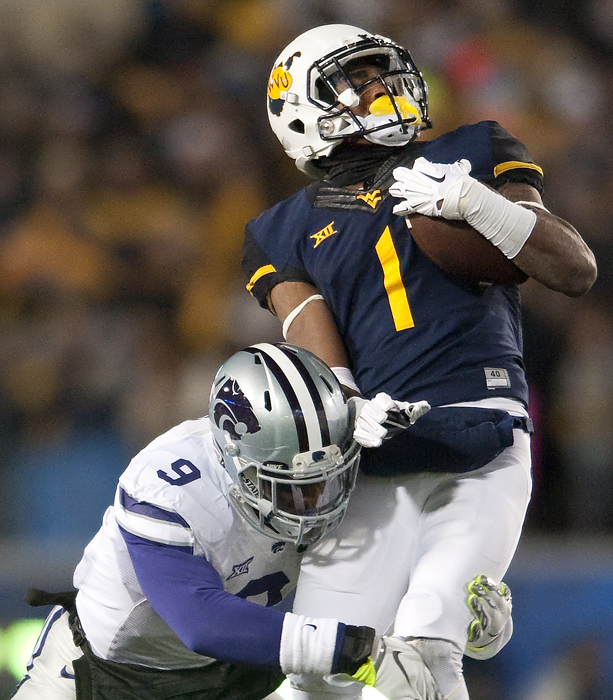 West Virginia wide receiver Shelton Gibson (1) attempts to spin around Kansas State linebacker Elijah Lee (9) at Milan Puskar Stadium on Thursday, Nov. 20, 2014 in Morgantown, W.Va.