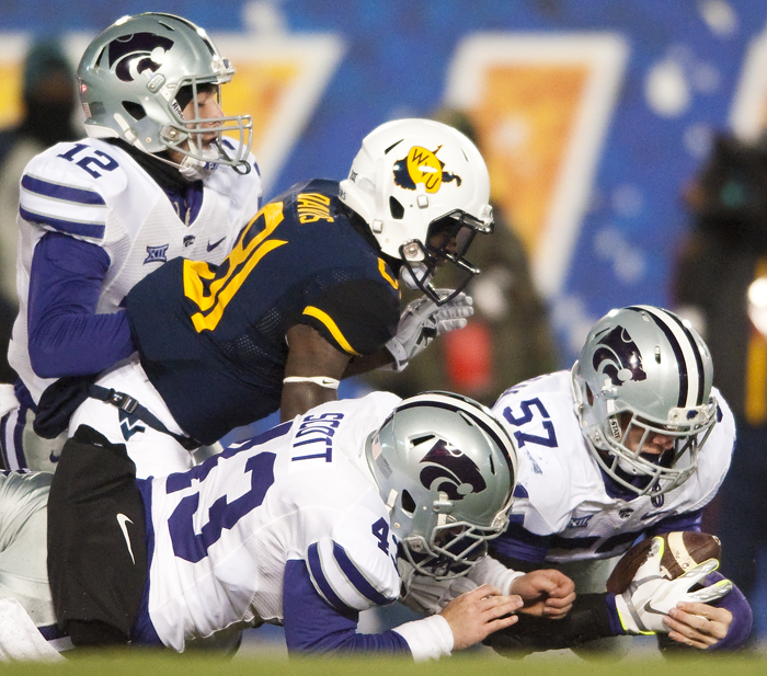 Kansas State linebacker Colborn Couchman (57) covers a fumble by West Virginia wide receiver Vernon Davis (81) on a punt return at Milan Puskar Stadium on Thursday, Nov. 20, 2014 in Morgantown, W.Va. Kansas State won 26-20.